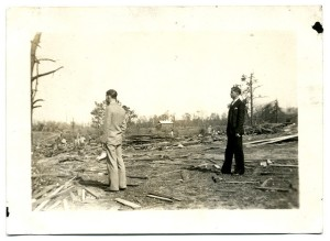 Two men view damage from the tornado outbreak