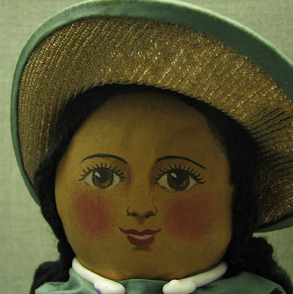 Detail showing hand-painted face