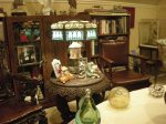 Maryon Allen's parlor crowded with memorabilia from days in Washington D.C. The Allen Senate chair is far right.