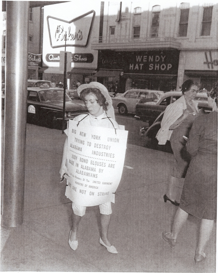 A woman in Birmingham pickets against the boycott of Alabama-made Judy Bond blouses. The nationwide boycott was organized by the International Ladies Garment Workers Union after the company moved production to a Brewton, Alabama, plant in 1961.