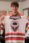 Intern Keith DePew with a Bulls' jersey from the center's collection.