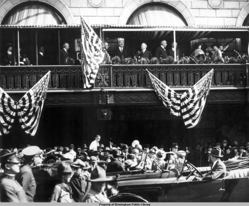 President Warren G. Harding, just right of the flag, on the Tutwiler Hotel balcony during the city's first 50 year anniversary festivities, 1921. Courtesy Birmingham Public Library Archives [collection i.d. OVH119]