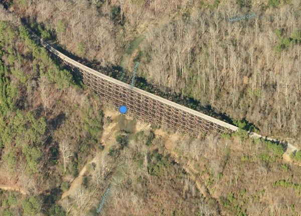 This Bing Maps aerial view shows the #10 trestle in its proper magnificence, according to a descendant of trestle builder J. L. Mitchell.